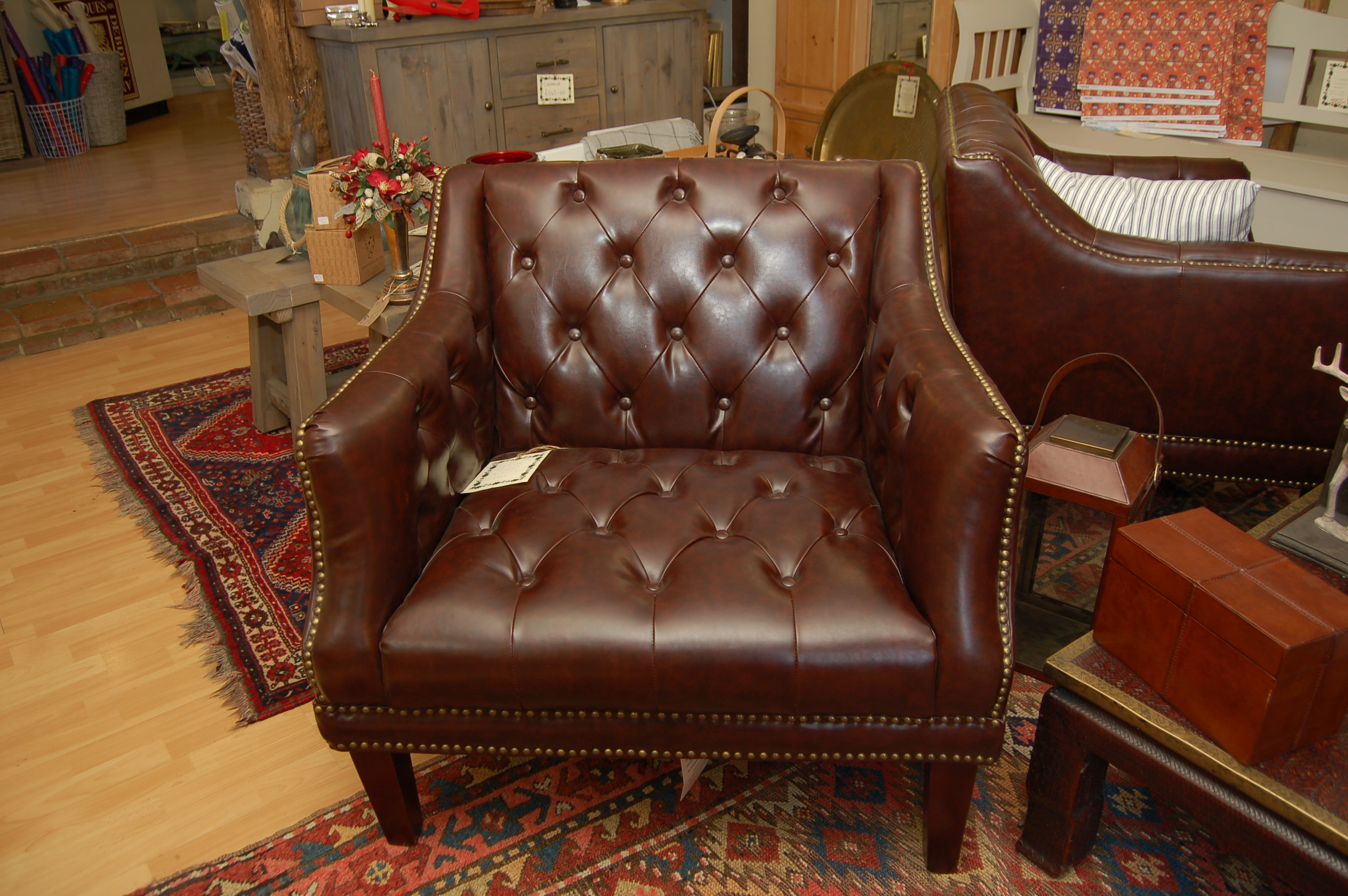 Leather and brass studded armchair - Debden Barns